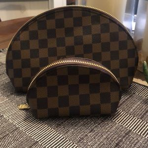 Handbags - NWOT checkered cosmetic bags. Set of 2.